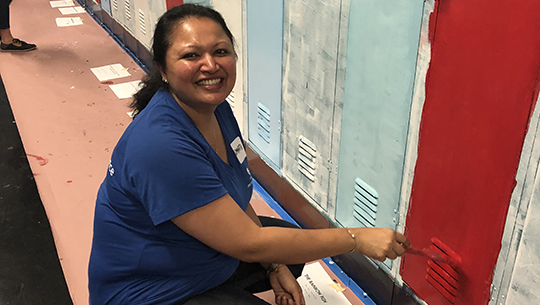 Painting lockers at Chicago's Jungman School.